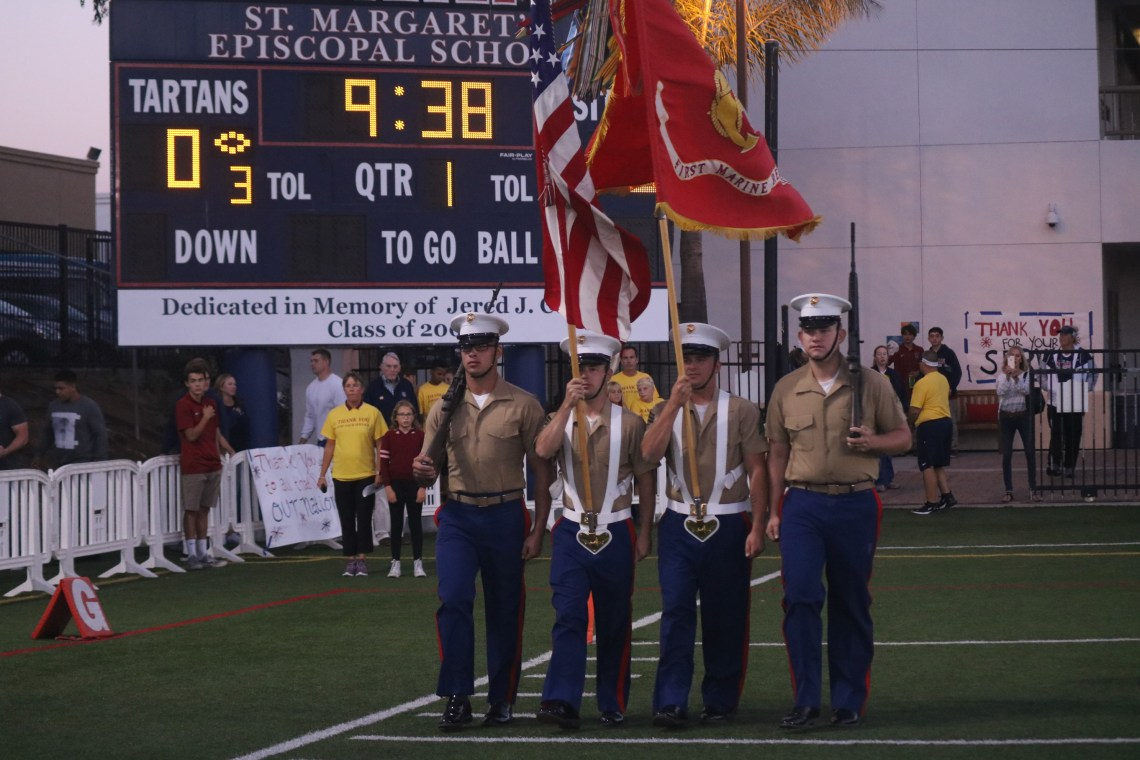 Military color guard takes the field prior to St. Margaret's football Military Appreciation Night. Photo: Zach Cavanagh