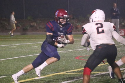 St. Margaret's Alex Lanham runs the ball against Bishop Diego. Photo: Zach Cavanagh