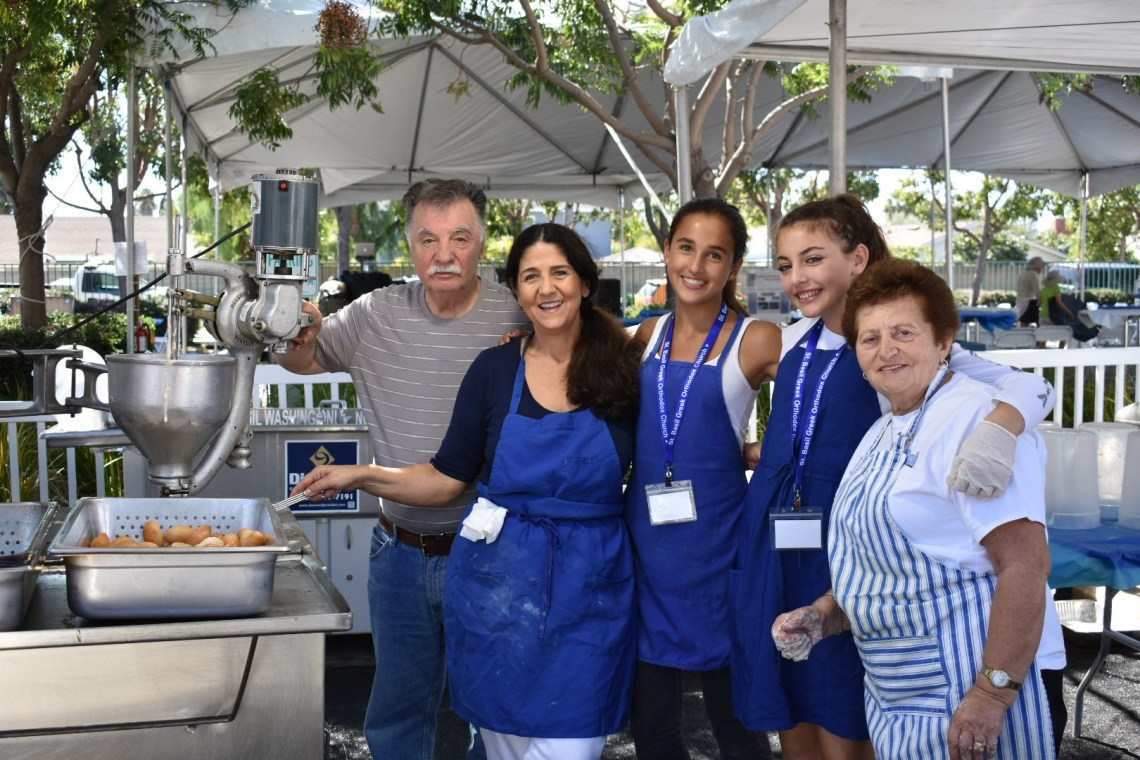 Lambros Pappas, 83, Fippi Zeppos, 67, Kathy Zeppos, 14, Katerina Domingo, 14 and Popi Kesoglou, 69, were busy at work on Saturday, Sept. 29, making loukoumades. Loukoumades are a Greek donut holes coated in honey and syrup. Photo: Alex Groves