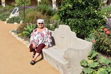 Martha Orozco of San Juan Capistrano sits at Mission San Juan Capistrano. She works as an usher there during her free time. Photo: Alex Groves