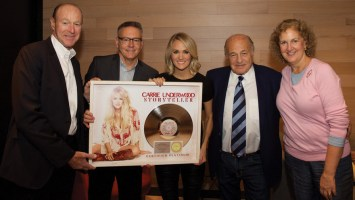 On the eve of her sold-out Madison Square Garden concert on The Storyteller Tour - Stories in the Round, Carrie Underwood was surprised by Sony Music executives in New York when they presented a plaque commemorating the RIAA Platinum certification of her 19 Recordings/Arista Nashville Storyteller album.  Pictured (left to right) are: Kevin Kelleher, Executive Vice President and Chief Financial Officer, Sony Music Entertainment; Randy Goodman, Chairman and CEO, Sony Music Nashville; Carrie Underwood; Sony Music Entertainment's Doug Morris, CEO, and Julie Swidler, Executive Vice President, Business Affairs and General Counsel.    Photo credit: Dan Callister