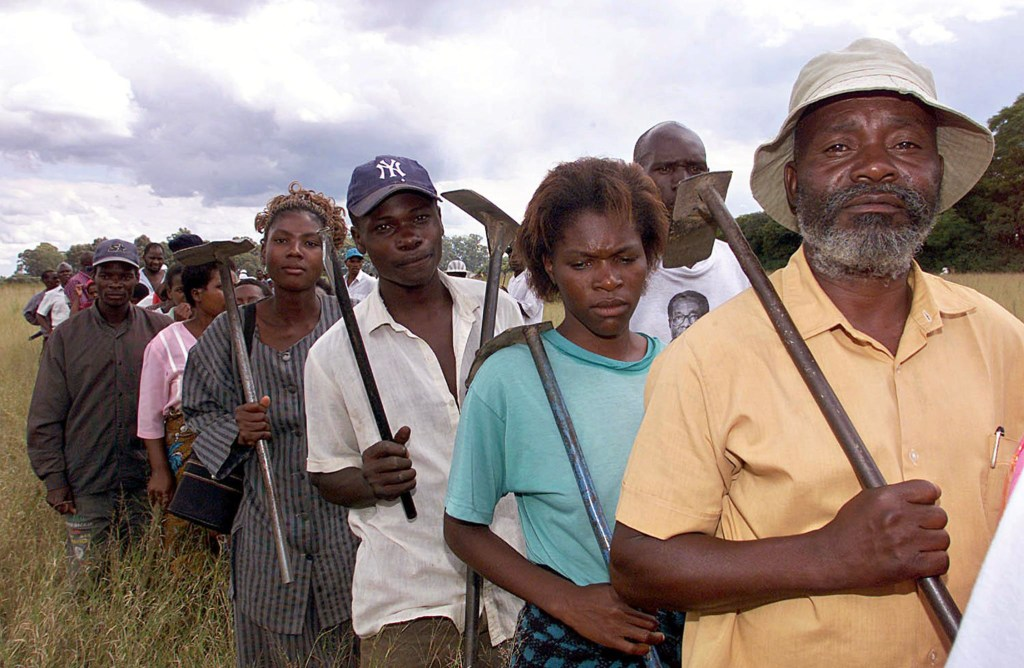 Zimbabweans line up to go and work at Bunkshill farm owned by a white man and occupied by armed war veterans in Harare April 13. Zimbabwe's acting president, [Joseph Msika], asked war veterans who have invaded more than 1,000 white-owned farms in recent months to move off the properties, the state-run ZIANA news agency said on Thursday. - RTXJQEH