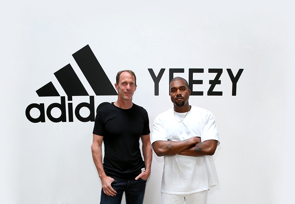(L-R) adidas CMO Eric Liedtke and Kanye West at Milk Studios on June 28, 2016 in Hollywood, California. adidas and Kanye West announce the future of their partnership: adidas + KANYE WEST