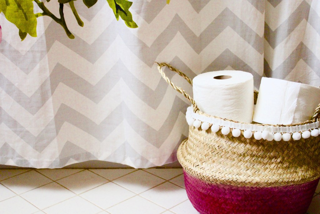 Dip dyed wicker basket perfect to store toilet paper in a guest bathroom!