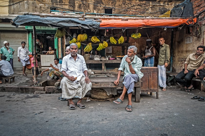 After a day's work men sit and relax in their market.