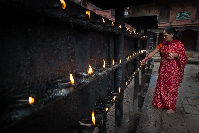 Lighting oil candles for morning puja.f/2.8, 1/150 sec, at 14mm, 200 ISO, on a X-Pro1