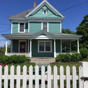 Jack and Fay's lovely home in Stonington, complete with a white-picket fence.