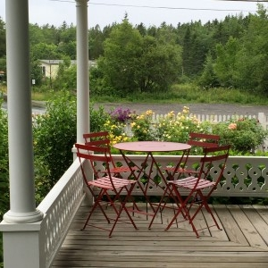 I love wraparound porches for their welcoming you to sit and enjoy the view and talk about writing and novels.