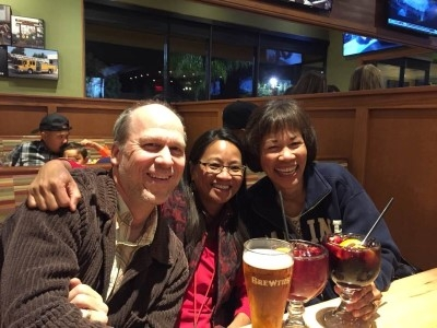 Winding down a great visit with sangria and beer, with my cousin Janet and her husband, Tim (courtesy of Debi Ecobiza).