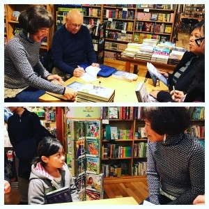 Signing books with Bob, and meeting Devin's daughter, Vita (photo courtesy of Devin Israel Cabanilla).