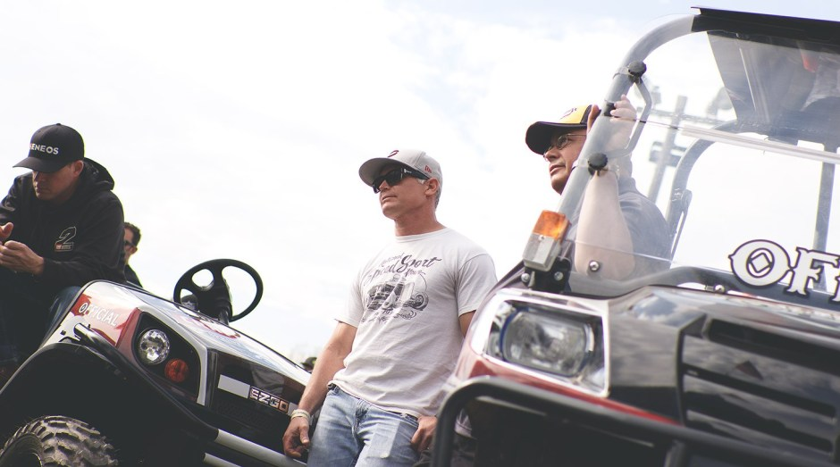 Joey Saldana talks with former car owner Dan Motter during the World of Outlaws drivers meeting at Weedsport Speedway