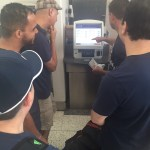 How many men does it take to figure out how to use check in machine?