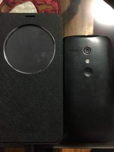 Asus ZenFone 2 and Moto G side by side.