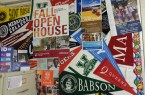 The college officer provides a display of many different colleges.