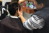 Customer getting her routinely trim at Flores Unisex Beauty Salon.