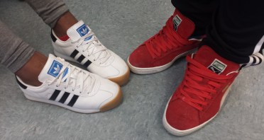 The white Adidas are kept clean unlike the red Pumas.