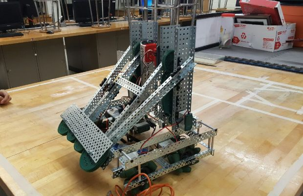 The Vex Robotics team's work on the internal components of their creation.