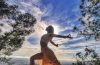 Krystal Aranyani practicing yoga in nature. Credit to Koi Fresco.