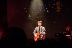 "Alec Benjamin singing ""Water Fountain"" in front of an audience of about 1,500 people at Irving Plaza."
