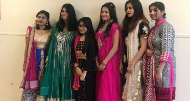 Some of the many young women dressed in their traditional clothing for Multicultural Day at Thomas A. Edison High School.