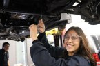Cindy Ronquillo working on a client's car in the automotive shop.