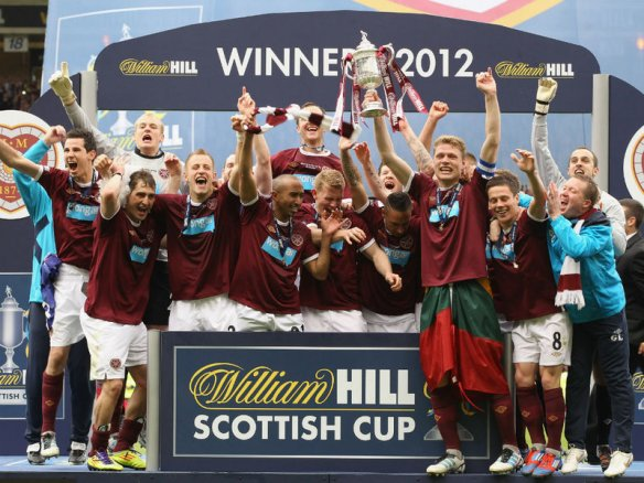 That was then...: Hearts celebrate their 2012 Scottish Cup triumph over Hibs in the final