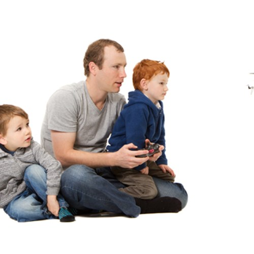 Father and sons playing kids helicopter game