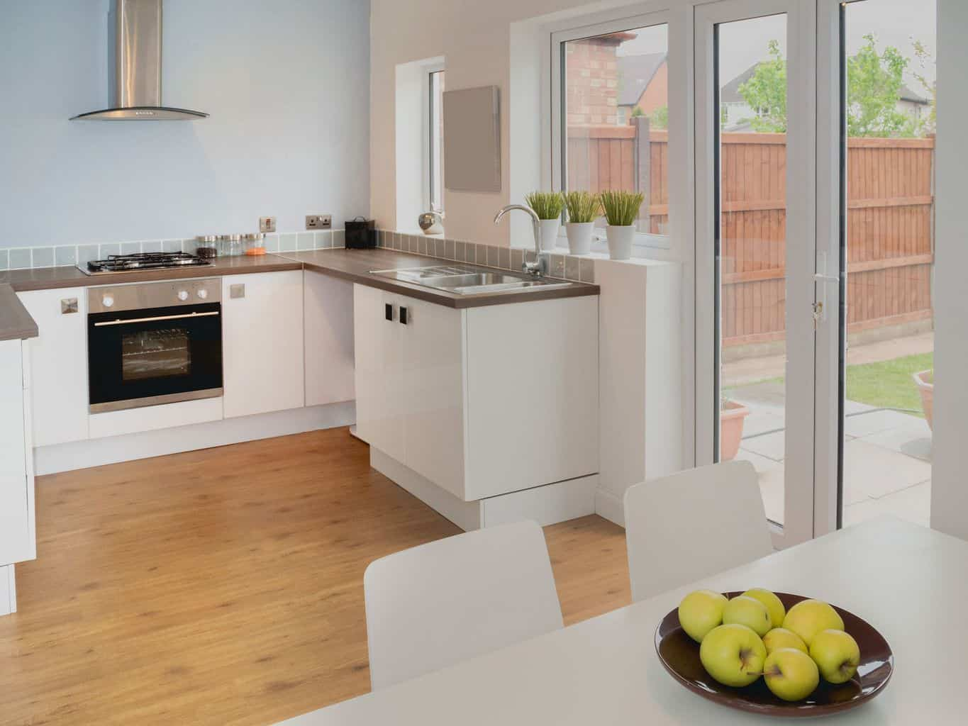 choose laminate flooring kitchen laminate flooring in kitchen Though you can t sand laminate like you could hardwood many people have trouble telling the difference between laminate wood and real hardwood
