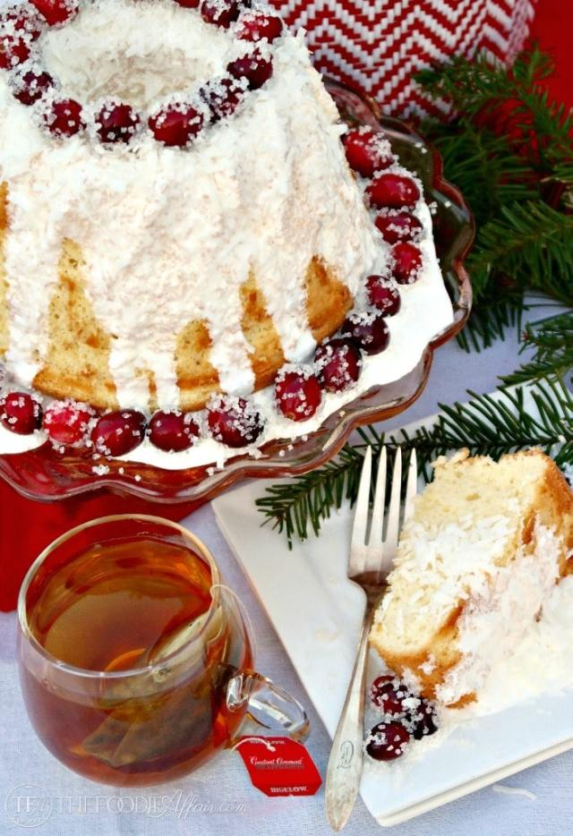 Vanilla Chiffon Cake with Sugared Cranberries is a light and airy cake served with hot tea. Enjoy for a special occasion. The Foodie Affair