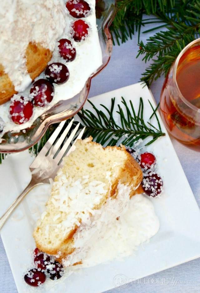 Vanilla Chiffon Cake with Sugared Cranberries is a light and airy cake that compliments any main dish. Enjoy for a special occasion. The Foodie Affair
