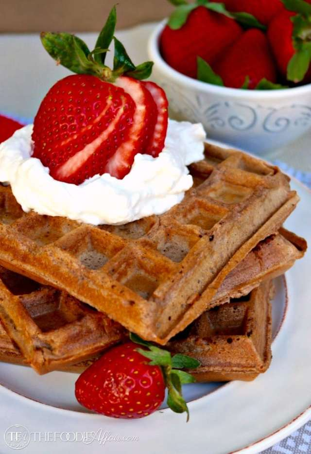 Delicate Whole Wheat Chocolate Waffles with almond meal for an extra dose of protein. Serve with fruit and freshly whipped cream! The Foodie Affair