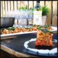 Salmon tartar with wine on table