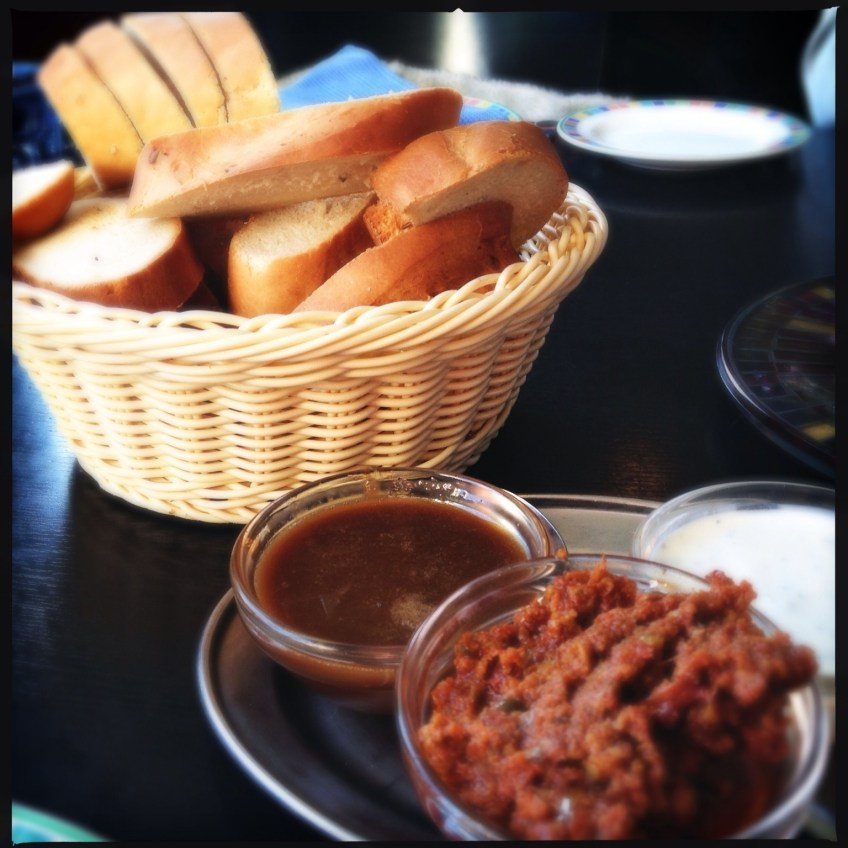 Bread served with three different dips