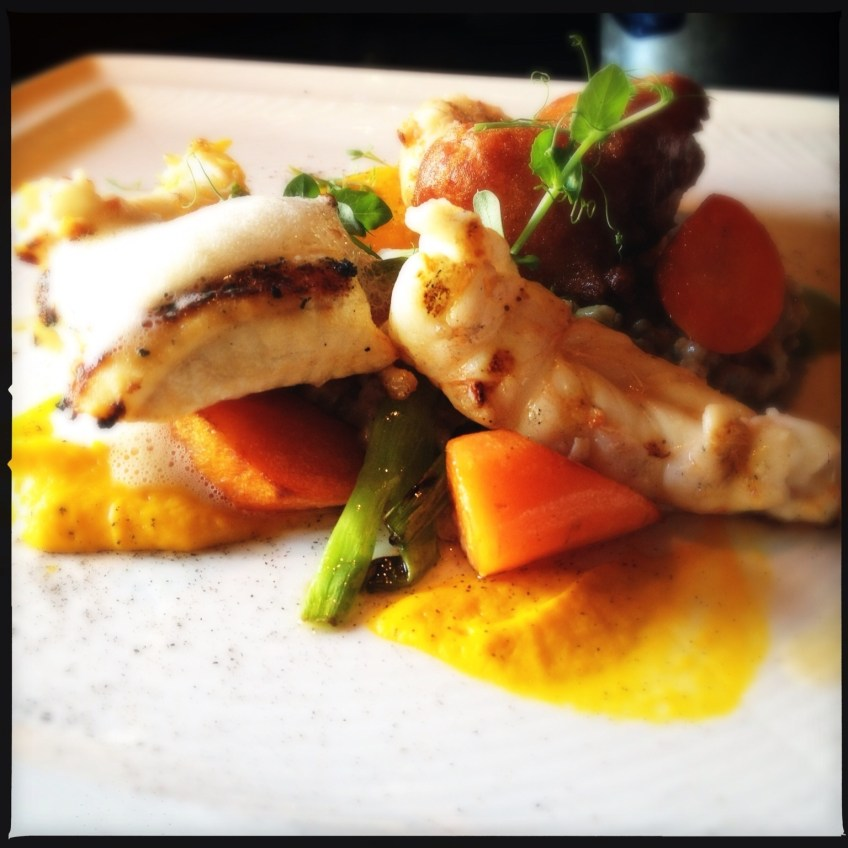 Spotted wolffish and lobster tails with carrot purée, Icelandic barley, spring onions, carrots topped with seafood foam