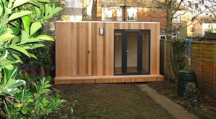 Garden studios with storage by garden spaces the garden for Garden studio uk