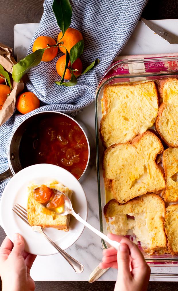 Brioche french toast casserole topped with mandarin orange segment ...