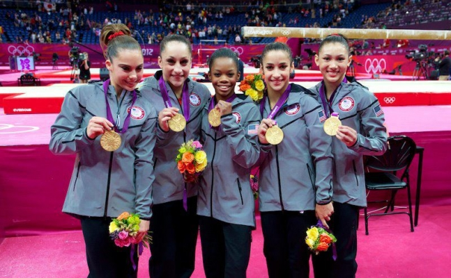 Jordyn Wieber's (second from left) faith helps her bounce back after disappointments like her narrow miss from individual competition. She helped her team win gold.