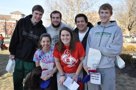 Students put their lunches and personal belongings on the bus before receiving a blessing for the 60-hour trip.