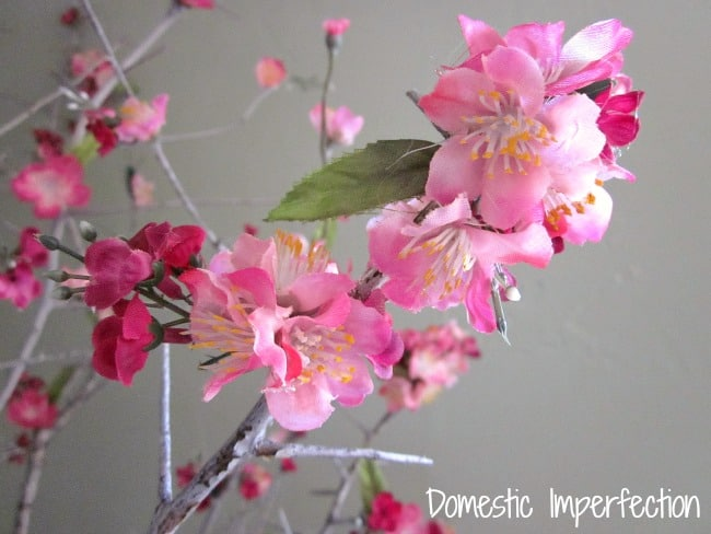 faux flowers on branch domestic imperfection