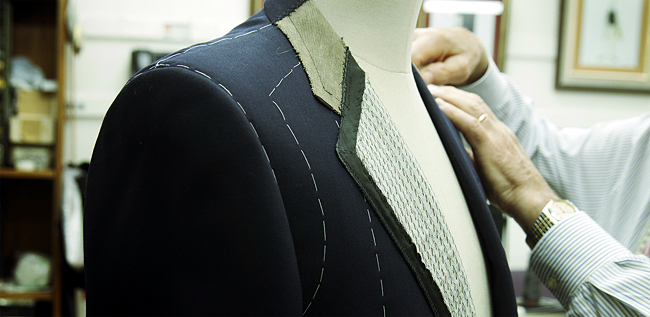 A basted fitting, part of the bespoke process. [Photo by Lawrence Cortez]