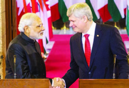 Prime-Minister-of-Canada-Stephen-Harper-and-Narendra-Modi-Prime-Minister-of-India-shake-hands-following-a-joint-press