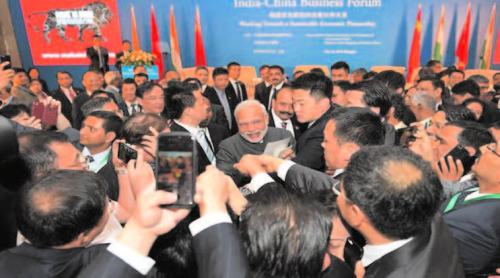 Prime Minister Modi interacts with people at the India China business forum  (Photo courtesy: Twitter/PIB)