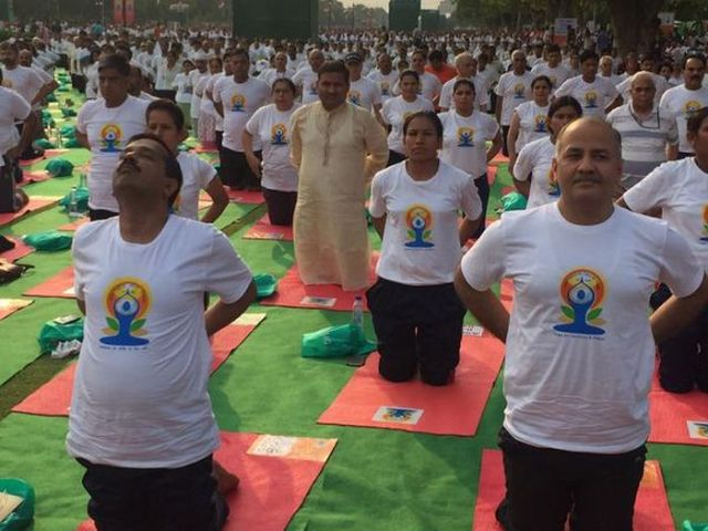Delhi Chief Minister Arvind Kejriwal, who practices yoga daily alongwith Deputy Chief Minister Manish Sisodia joined PM Modi