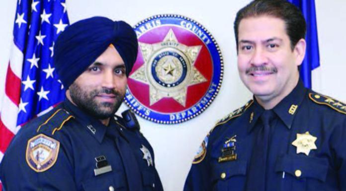 Deputy Sandeep Singh Dhaliwal and Sheriff Adrian Garcia
