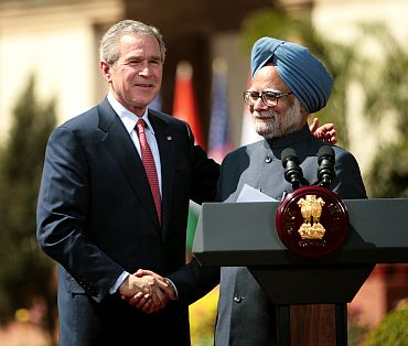 India's Prime Minister Dr. Manmohan Singh and US President George Bush shake hands after India and the United States sealed a civilian nuclear cooperation pact, in New Delhi