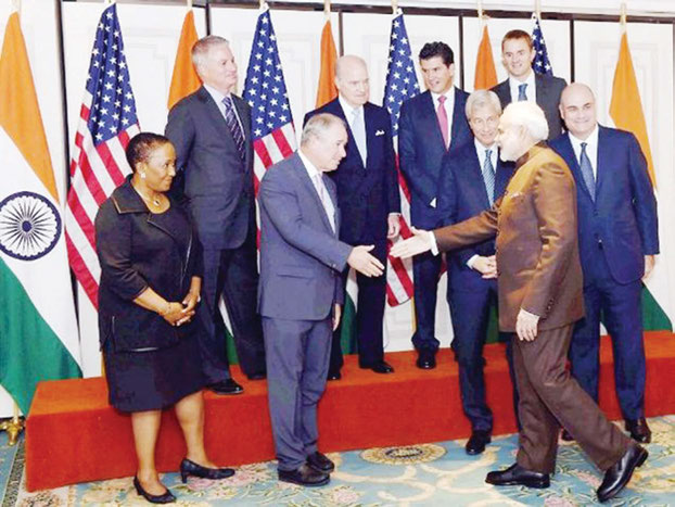 Prime Minister Narendra Modi with officials of top Financial institutions before a meeting with them in New York on Thursday, September 24