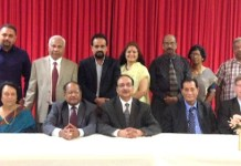 Attached photo: Immigration panelists with organizers. From l. to r. in the front row: Sudha Acharya, Dr. Thomas Abraham, Anand Ahuja, Michael Phulwani, David Nachman and Inderjit Singh