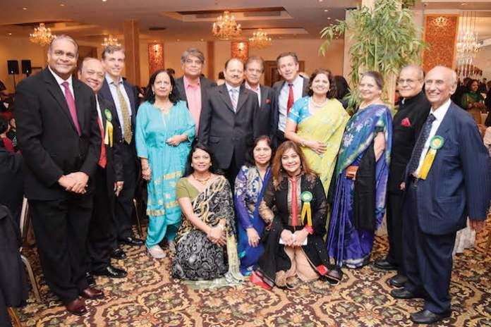 From Right to Left: President Chandra Mehta, Founder and Chairman H.K. Shah, Kirti Shukla, Flora Parekh (VP), Mrs. Suman Munjal, Mrs. Dipika Modi, Ms. Nivea Kothari (Youth Chair), Dr. Krishna Jhaveri In the back, from Left to Right: Dr. Uttam Munver, Mr. Minesh Desai (Treasurer), Mr. Bob Dibeneditto, Mr. Vinod Shah (Director), Dr. Joel Kahn (Speaker), Mr. Kanak Golia, Mr.Paresh Parekh