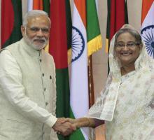 Prime Minister Narendra Modi and Bangladesh Prime Minister Sheikh Hasina shake hands in Dhaka, Bangladesh, Saturday, June 6, 2015.