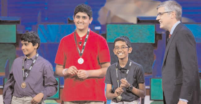 Rishi Nair (second from right) a sixth grader from Florida took top honors at the 28th annual National Geographic Bee held at the National Geographic headquarters in Washington, May 25.